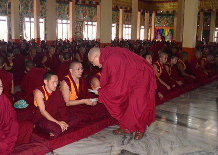 Geshe la Phelgye makes offerings at Sera Jey