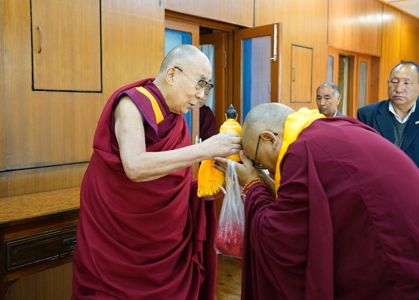 Dalai Lama blesses Geshe la Phelgye with Buddha Statue